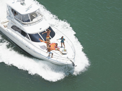 An aerial shot of a group of people at sea on a Private Yacht Charter.