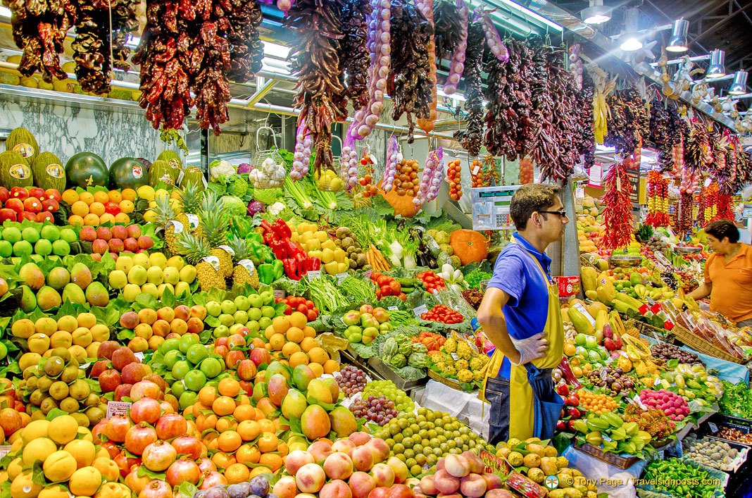 A photo of a fruit and vegetable stall in La Boqueria in Barcelona.